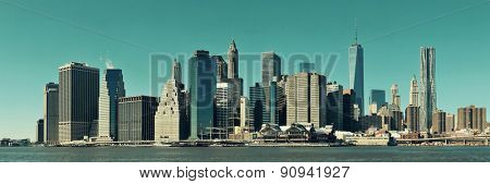 Manhattan financial district with skyscrapers over East River.