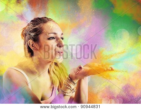 Girl blowing colored powders