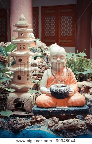 Statue meditation novices in thailand.Temple in Thailand.Zone Asia
