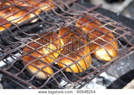 Sausages grilled over charcoal