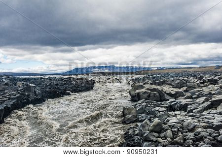 Beautiful Icelandic river with dramatic sky. It is located in the centre of the island, near Kjolur road.