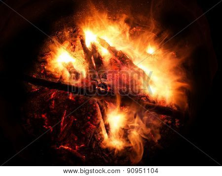 Wooden Fire Burning On A Dark Background