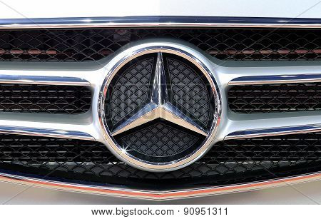 Close Up Logo Of Mercedes Benz On Bumper
