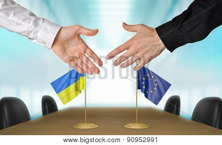 Ukraine and European Union diplomats agreeing on a deal