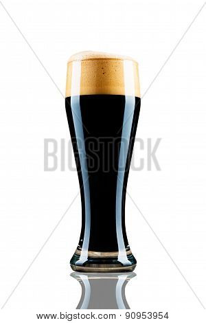 Dark beer in the glass isolated on white