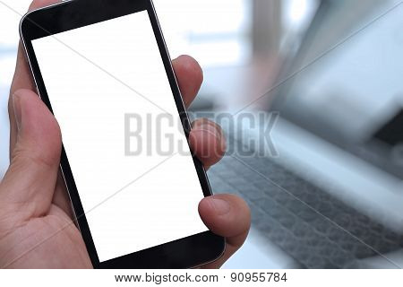 Closeup Of Hand Holding Blank Screen Of Smart Phone With Blurred Background As Concept