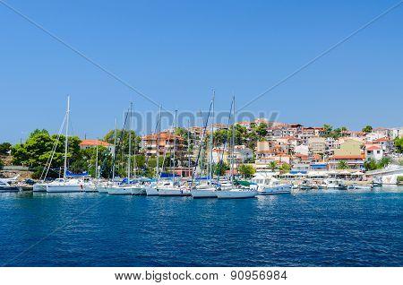 Yachts Near Pier Of Resort Town Neos Marmaras, Sithonia, Greece