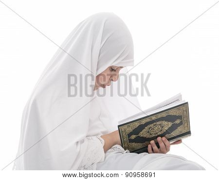 Little Young Muslim Girl Reading Quran Holy Book
