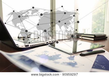 Business Documents On Office Table With Smart Phone And Stylus Pen And Laptop Computer With Social N