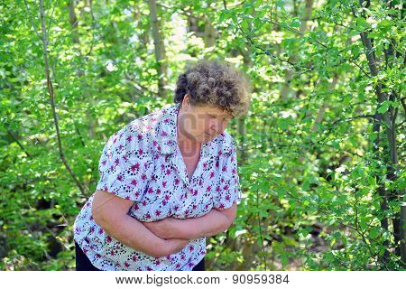 Mature Woman With Abdominal Pain In Nature