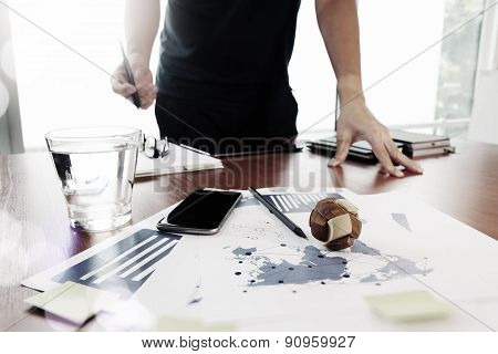Moving Image Of Business Creative Designer Working Wooden Texture Globe With Smart Phone On Business