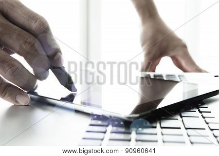 Designer Hand Working With Stylus And Digital Tablet And Laptop On Wooden Desk In Office