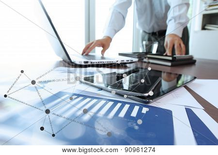 Business Documents On Office Table With Digital Tablet And Man Working With Smart Laptop Computer Ba
