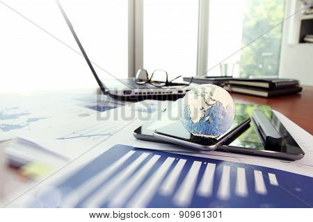 Business Documents On Office Table With Texture The World On Smart Phone And Digital Tablet As Work