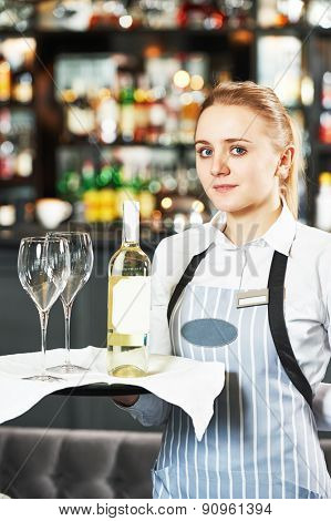 Waitress with menu at the indoor restaurant service