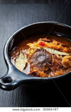 Hearty cabbage soup  - Sauerkraut soup -  with mushrooms