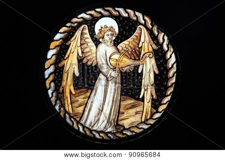 Angel playing a rebeck stained glass window