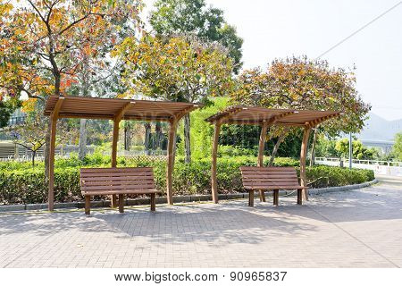 Rustic Pergolas With Benches Under Blossoming Trees
