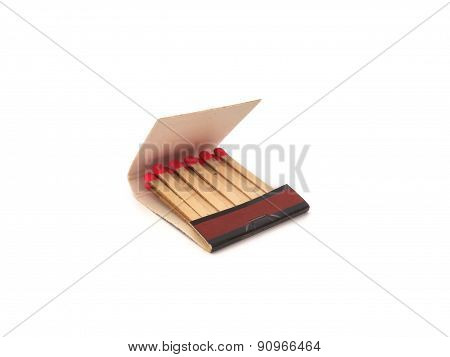Opened matchbook with red matchsticks isolated on white background