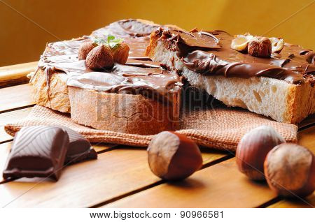 Bread With Chocolate Cream And Hazelnuts Brown Background