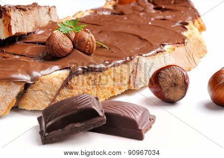 Bread With Chocolate Cream And Hazelnuts Closeup