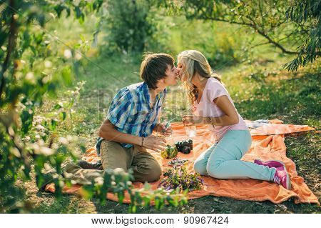 Teenage Couple Kissing On Picnic