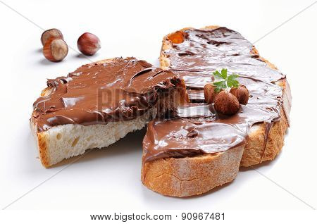 Bread With Chocolate Cream And Hazelnuts Isolated