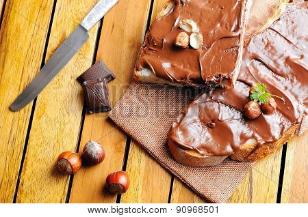 Bread With Chocolate Cream And Hazelnuts On A Table Top