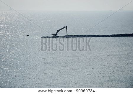 Dike Construction Into The Sea