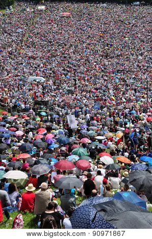 Thousands Of Catholic Pilgrims Praying In The Outdoors During The Pentecost