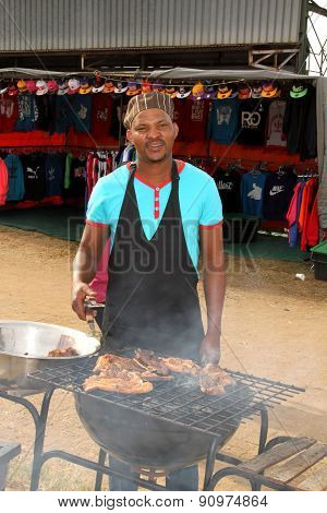 African Man Busy With Barbecue