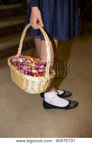 Close-up Of A Flowergirl Holding A Basket