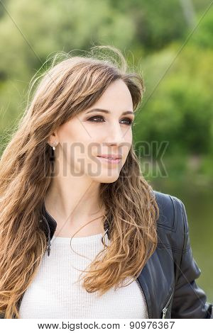 Young Cheerful Woman Looking Sideways At  Outdoors