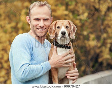 Man with favorit beagle dog pet handsome portrait