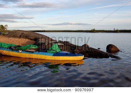 Kayak on the bank of the lake.
