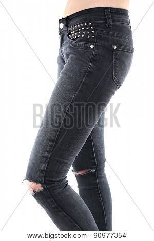 Girlish legs in torn jeans close up