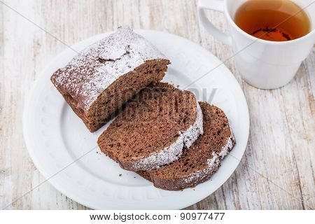 Tasty Dark Gingerbread Cake On Plate On Wooden Table