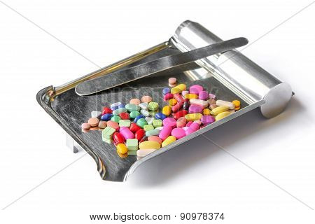 Colorful tablets medicine on the drug counting tray.