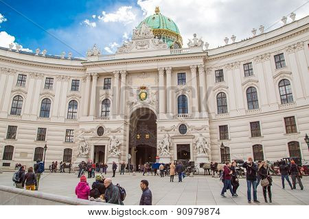 People walking at Michaelerplatz in Vienna, Austria
