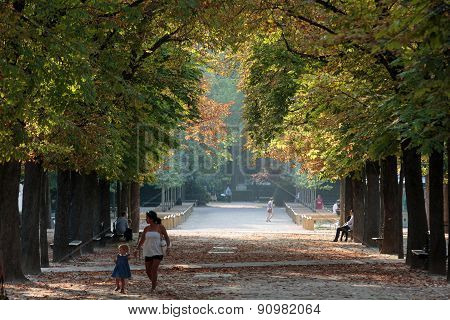 People relax in Luxembourg Gardens in Paris France.