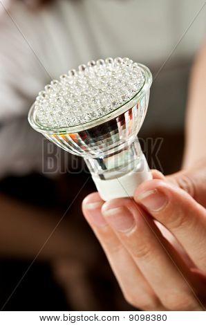 led light bulb in hand