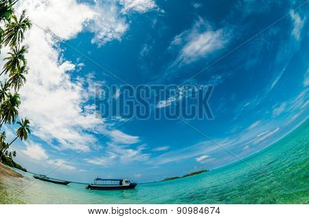Blue Sky Above A Boat At The Seashore