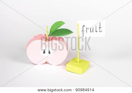 isolated paper apple and card with word