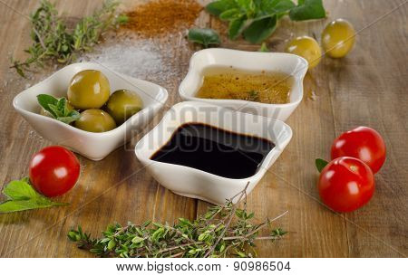 Dressing Ingredients On A Wooden Background.