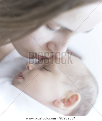 Mother Kissing Her Newborn