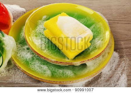 Dishes in foam with wisp on table close up