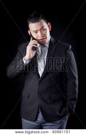 Portrait Of Asian Business Man Talking Mobile Phone Against Blac Background Photography By Low Key L