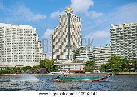 BANGKOK, THAILAND - February 19, 2015: traditional boat on the Chao Phraya River, that flows through Bangkok. It is one of the largest and most important rivers in Thailand. It has a length of 370 km