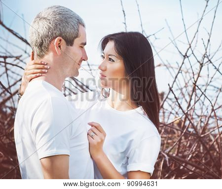 Portrait Of Happy Young Couple Outdoors