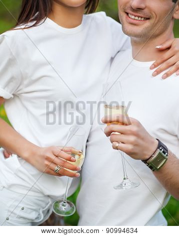 Happy Smiling Couple Drinking Champagne On Picnic